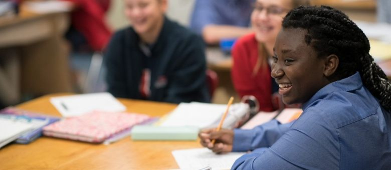 A middle school girl takes notes in class at Dayspring Christian Academy in Lancaster, PA.
