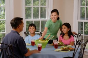 Children learn responsibility when their parents interact with them at the dinner table.