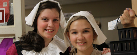 Dayspring students volunteer at Thanksgiving Exposed to show the Pilgrims' story.