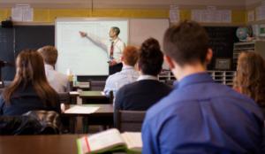 A Dayspring teacher in the classroom teaching an Advanced Math Course.