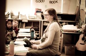 A Dayspring teacher reads to her class.
