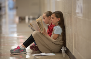 Two Dayspring students read in the hallway of the school.