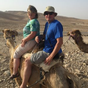 Dr. Myers, Headmaster of Dayspring Christian Academy, rides a camel with his wife as they teach seniors about the life of Jesus in Israel.