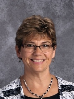 Sally Armstrong is a music teacher and lower school aide