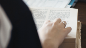 A female student at Dayspring Christian Academy in Lancaster, PA studies a book written in Greek.