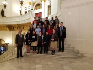 Dayspring students stand on the steps in the Capitol Building In Harrisburg, PA