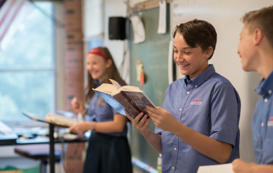 Christian middle school students reading in class