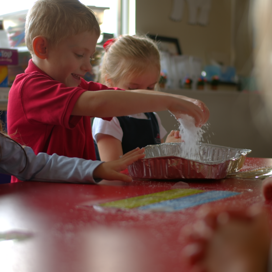 Boy and Girl Christian Preschool Students Learning Together